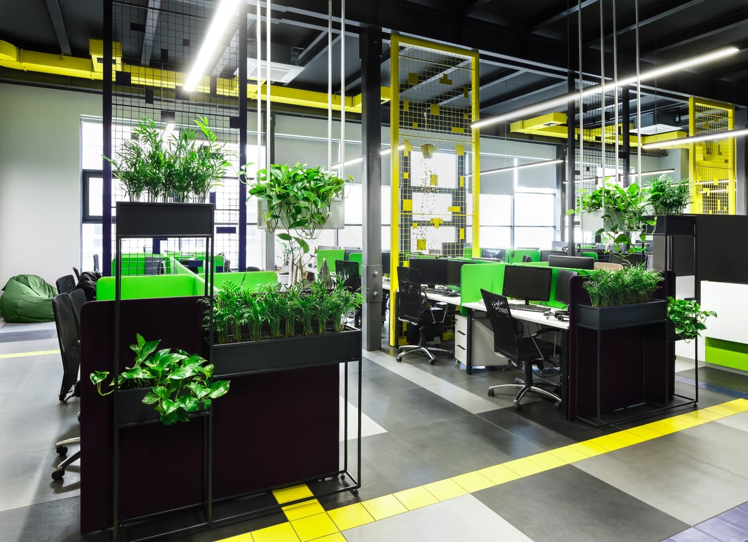 Improved work efficiency. Modern office interior in loft style in grey, green and yellow colors